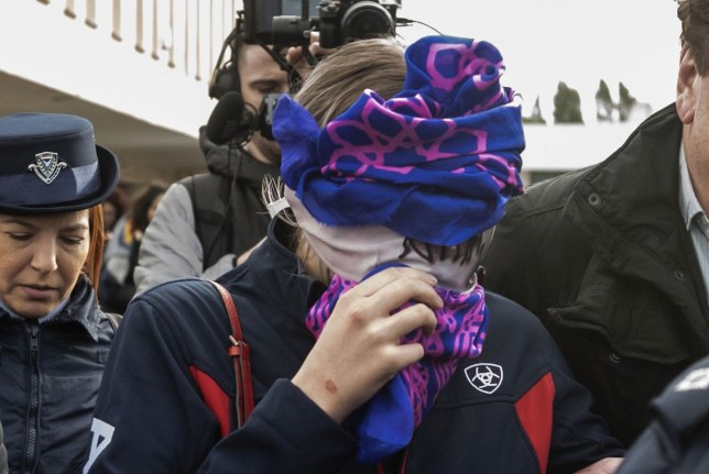 A British teenager (C) accused of fasely claiming she was raped by Israeli tourists, covers her face as she leaves after the verdict at the Famagusta District Court in Paralimni in eastern Cyprus, on December 30, 2019. - The Briton who had alleged 12 Israeli tourists gang raped her on July 17, at a hotel in the eastern resort of Ayia Napa, has been found guilty of lying by a Cypriot court, her sentencing adjourned until January 7. (Photo by Iakovos Hatzistavrou / AFP) (Photo by IAKOVOS HATZISTAVROU/AFP via Getty Images)