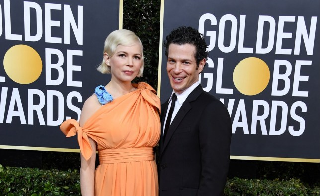 Michelle Williams and Thomas Kail attends the 77th Annual Golden Globe Awards at The Beverly Hilton Hotel