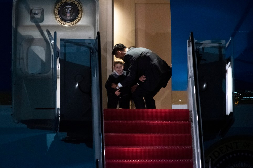 A Secret Service agent stops Theodore James Kushner, a son of Ivanka Trump, from exiting Air Force One on Sunday January 5, 2020, at Andrews Air Force Base following a trip from Trump's Mar-a-Lago estate