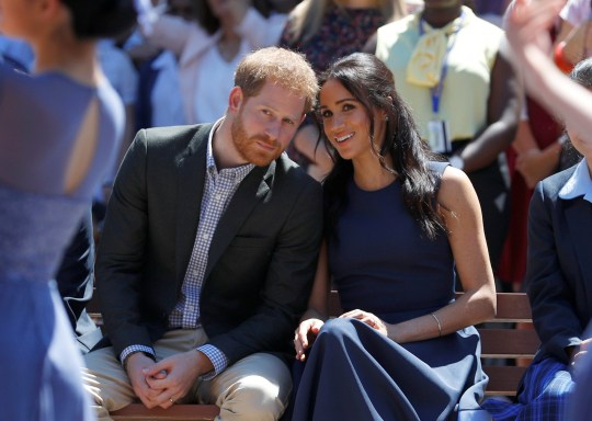 SYDNEY, AUSTRALIA - OCTOBER 19: Prince Harry, Duke of Sussex and Meghan, Duchess of Sussex watch a performance during their visit to Macarthur Girls High School on October 19, 2018 in Sydney, Australia. The Duke and Duchess of Sussex are on their official 16-day Autumn tour visiting cities in Australia, Fiji, Tonga and New Zealand. (Photo by Phil Noble - Pool/Getty Images)