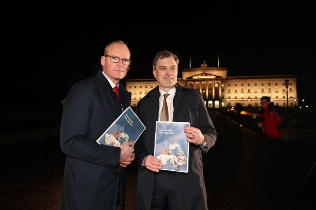 Irish Foreign Affairs minister Simon Coveney (left) and Secretary of State for Northern Ireland Julian Smith, issue a statement outside Stormont Parliament buildings in Belfast, where meetings with parties involved in talks to resurrect the devolved government in Northern Ireland have been taking place. PA Photo. Picture date: Thursday January 9, 2020. See PA story ULSTER Politics. Photo credit should read: Niall Carson/PA Wire