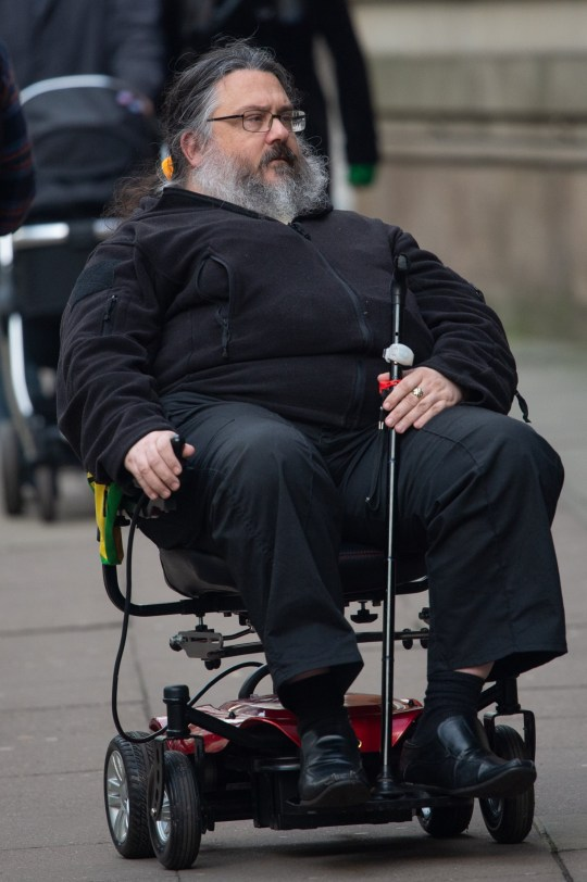 Struck-off solicitor-advocate Alan Blacker arriving for sentence at Minshull street crown court. Incriminating pictures show crooked lawyer Alan Blakcer walking freely around a courthouse - whilst illegally pocketed ??60,000 in disability handouts by falsely claiming he could barely walk.Disclaimer: While Cavendish Press (Manchester) Ltd uses its' best endeavours to establish the copyright and authenticity of all pictures supplied, it accepts no liability for any damage, loss or legal action caused by the use of images supplied. The publication of images is solely at your discretion. For terms and conditions see http://www.cavendish-press.co.uk/pages/terms-and-conditions.aspx