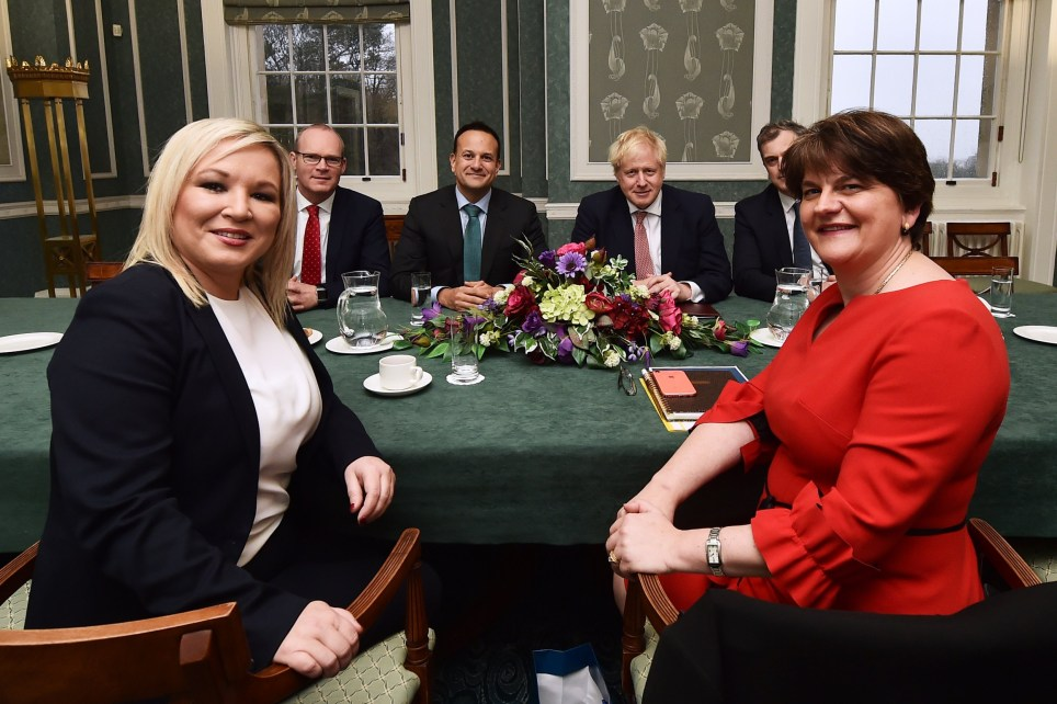 BELFAST, NORTHERN IRELAND - JANUARY 13: (L-R) First Minister Michelle O'Neill of Sinn Fein, Deputy Leader Simon Coveney of Fine Gael, Taoiseach, Leo Varadkar, British Prime Minister Boris Johnson, Julian Smith, Secretary of State for Northern Ireland and First Minister Arlene Foster of the DUP during a meeting at Stormont on January 13, 2020 in Belfast, Northern Ireland. (Photo by Charles McQuillan/Getty Images)