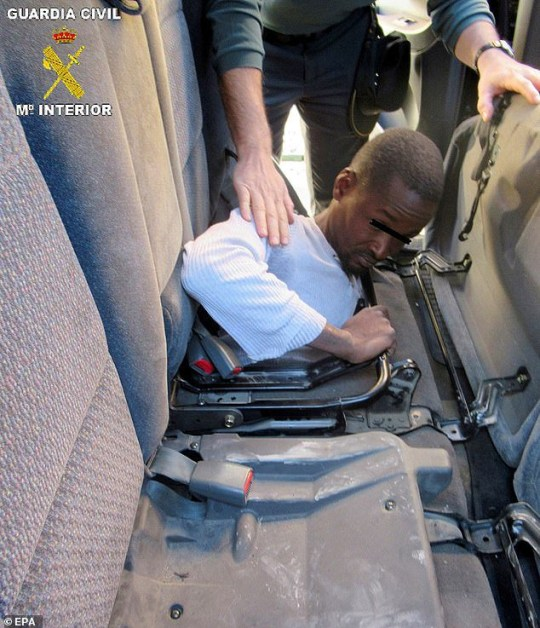 Fits like a glove (box)! Migrants are found hiding behind the dashboard and under the back seats of a car in a bid to enter Europe from North Africa Two teenage migrants found trying to cross into Spanish enclave of Mellila Both migrants were from Guinea and had to be cut out of the vehicle The 30-year-old Moroccan driver of the vehicle was arrested for trafficking