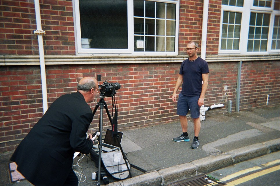 Anthony capturing photos of Fred, one of the people experiencing homelessness in the UK