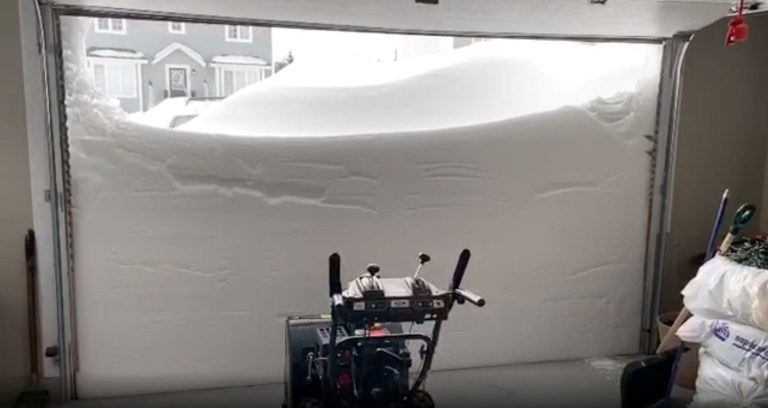Pile of snow outside a garage is pictured in St John's, Newfoundland And Labrador, Canada January 18, 2020 in this picture grab obtained from a social media video. J. David Mitchell/via REUTERS THIS IMAGE HAS BEEN SUPPLIED BY A THIRD PARTY. MANDATORY CREDIT. NO RESALES. NO ARCHIVES.