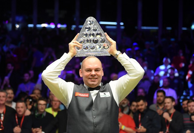 LONDON, ENGLAND - JANUARY 19: Stuart Bingham poses for a photo with the Paul Hunter Trophy after victory in the Final of the Dafabet Masters between Stuart Bingham and Ali Carter at Alexandra Palace on January 19, 2020 in London, England. (Photo by Alex Davidson/Getty Images)