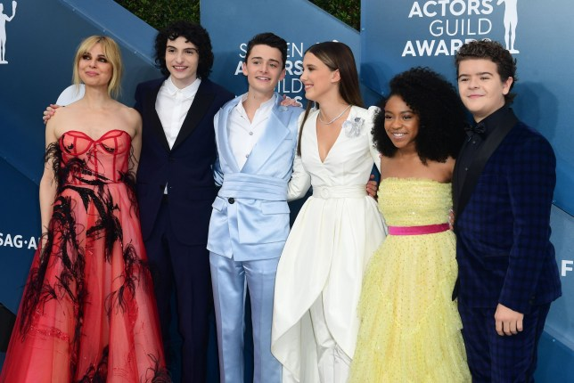 (L-R) Actors Cara Buono, Finn Wolfhard, Noah Schnapp, Millie Bobby Brown, Priah Ferguson and Gaten Matarazzo arrives for the 26th Annual Screen Actors Guild Awards at the Shrine Auditorium in Los Angeles on January 19, 2020. (Photo by FREDERIC J. BROWN / AFP) (Photo by FREDERIC J. BROWN/AFP via Getty Images)