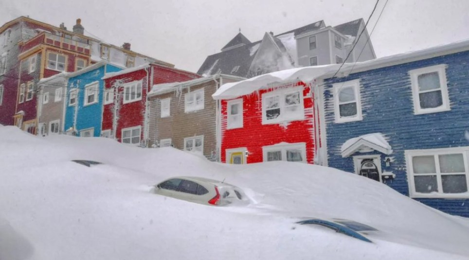 Cars are almost completely buried by snow in St John's, Newfoundland