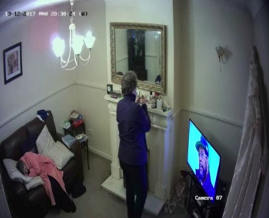 This is the moment a callous carer pocketed jewellery belonging to a grandmother with dementia -- while she slept on the sofa just a metre away. See SWNS story SWSYthief. Caroline Bastable, 42, was paid to look after Sheila Wade, 82, who suffered with breathing problems and vascular dementia. But her son John Wade, 59, noticed food and money was going missing from his mum's home - so installed a network of cameras for nearly two weeks. The bank director was horrified to uncover footage of heartless Bastable pocketing jewellery from the fireplace as Sheila slept on the couch in front of her.