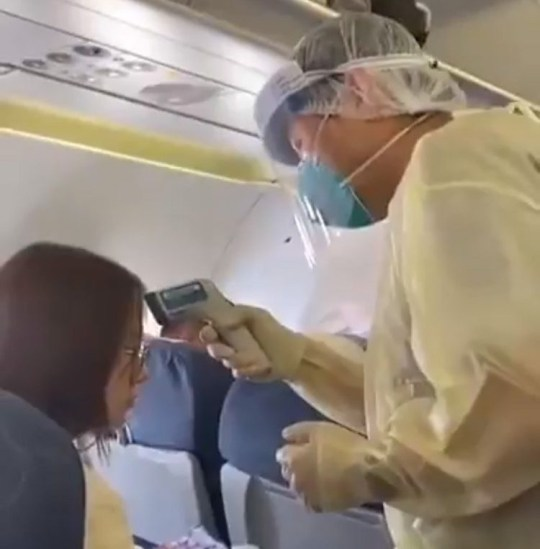 Passengers screened for coronavirus symptoms on a domestic flight out of Wuhan