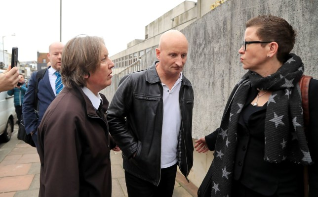 Steven Bouquet (centre) is escorted away from Brighton Magistrates Court after appearing on 16 counts of criminal damage over attacks in Brighton on cats between October 2018 and June 2019. PA Photo. Picture date: Thursday January 23, 2020. See PA story COURTS Cats. Photo credit should read: Gareth Fuller/PA Wire
