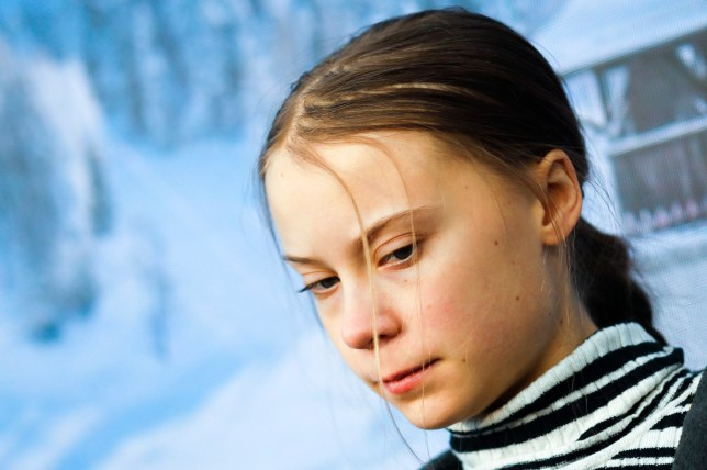 Swedish climate activist Greta Thunberg arrives for a news conference in Davos, Switzerland, Friday, Jan. 24, 2020. The 50th annual meeting of the forum is taking place in Davos from Jan. 21 until Jan. 24, 2020 (AP Photo/Markus Schreiber)