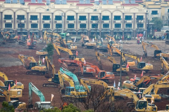 WUHAN, CHINA - JANUARY 25: Dozens of diggers work to build a new hospital in Wuhan, China on January 25, 2020. Due to the large number of infected people in the hospital, which could no longer accommodate more patients, the government decided to establish a temporary hospital, which will be completed on February 3. (Photo by Stringer/Anadolu Agency via Getty Images)
