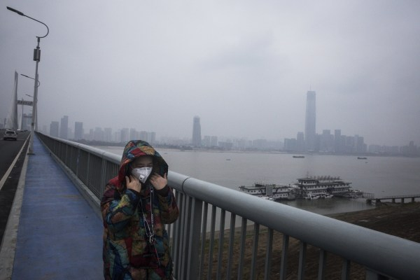 WUHAN, CHINA - JANUARY 27: (CHINA-OUT) A woman wears a protective mask as she walks across the Yangtze River Bridge on January 27, 2020 in Wuhan, China. As the death toll from the coronavirus reaches 80 in China with over 2700 confirmed cases, the city remains on lockdown for a fourth day. (Photo by Getty Images)