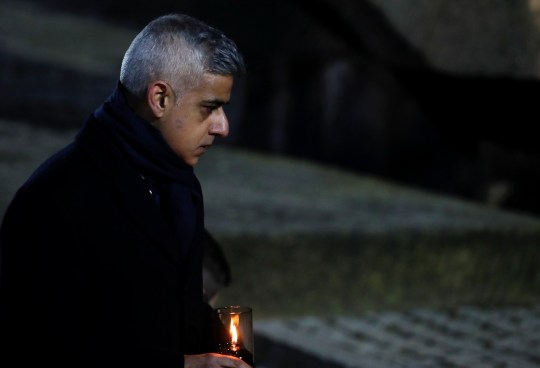 Mayor of London Sadiq Khan lights a candle at the Monument to the Victims at the former Nazi German concentration and extermination camp Auschwitz II-Birkenau, during ceremonies marking the 75th anniversary of the liberation of the camp and International Holocaust Victims Remembrance Day, in Brzezinka near Oswiecim, Poland, January 27, 2020. REUTERS/Aleksandra Szmigiel