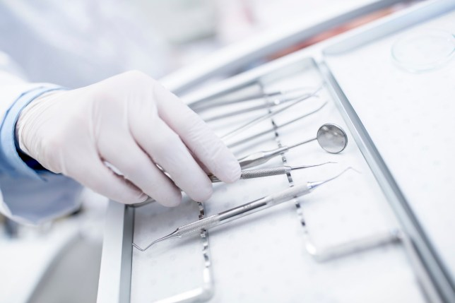 Close-up of dental equipment in dentists hand.