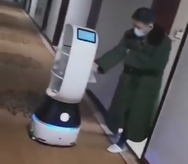 Pic Shows: A robot named 'Xiaohuasheng' (Little Peanut) delivers food to quarantined hotel guests in Hangzhou, China; This is the eerily cheerful robot delivering meals to over 200 hotel guests who were sent directly to individual rooms for quarantine just moments after landing in China.