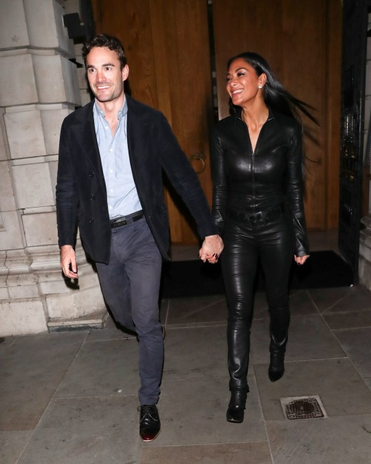 BGUK_1853883 - London, UNITED KINGDOM - Pussycat Doll singer Nicole Scherzinger looks sensational wearing leather catsuit, she steps out officially for the first time in London with boyfriend Thom Evans, they were pictured holding hands. Pictured: Nicole Scherzinger, Thom Evans BACKGRID UK 29 JANUARY 2020 UK: +44 208 344 2007 / uksales@backgrid.com USA: +1 310 798 9111 / usasales@backgrid.com *UK Clients - Pictures Containing Children Please Pixelate Face Prior To Publication*