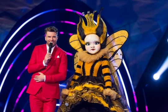 This image is strictly embargoed until 00.01 Friday 31st January 2020 From Bandicoot TV The Masked Singer: Ep6 on ITV Pictured: Joel Dommett and Queen Bee. This photograph is (C) Bandicoot TV and can only be reproduced for editorial purposes directly in connection with the programme or event mentioned above, or ITV plc. Once made available by ITV plc Picture Desk, this photograph can be reproduced once only up until the transmission [TX] date and no reproduction fee will be charged. Any subsequent usage may incur a fee. This photograph must not be manipulated [excluding basic cropping] in a manner which alters the visual appearance of the person photographed deemed detrimental or inappropriate by ITV plc Picture Desk. This photograph must not be syndicated to any other company, publication or website, or permanently archived, without the express written permission of ITV Picture Desk. Full Terms and conditions are available on the website www.itv.com/presscentre/itvpictures/terms For further information please contact: james.hilder@itv.com / 0207 157 3052