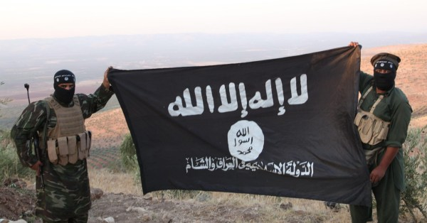 E2BR1X Oct 17, 2013 - Aleppo, Syria - ISIS fighters holding the Al-Qaeda flag with 'Islamic State of Iraq and the Levant' written on it. on the frontline. Islamic State of Iraq and the Levant aka ISIS. The group An-Nusra Front announced its creation January 2012 during the Syrian Civil War. Since then it has been the most aggressive and most effective rebel force in Syria. The group has been designated as a terrorist organization by the United Nations. April 2013, the leader of the ISIS released an audio statement announcing that Jabhat al-Nusra is its branch in Syria. (Credit Image: ? Medyan Dairieh