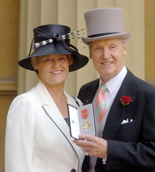 No Uk Rights Until 22/07/04 Picture must be credited ?Alpha 055205 22/06/04 Nicholas Parsons with his wife Annie after receiving a OBE from the Queen at a Investiture ceremony at Buckingham Palace London