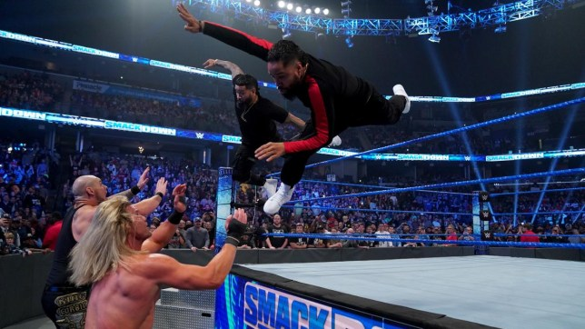 The Usos fly out of the WWE ring