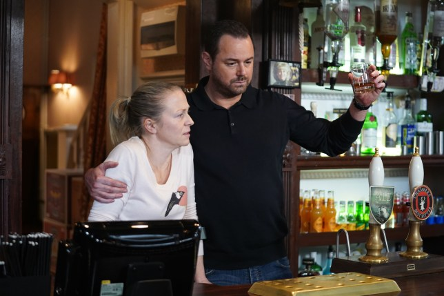 Mick and Linda raise a glass to Dennis in EastEnders
