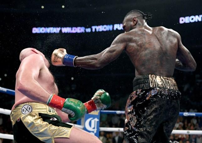 Deontay Wilder knocks Tyson Fury down