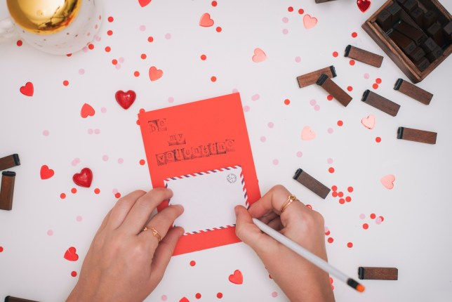 Woman writing a Valentine's Day card
