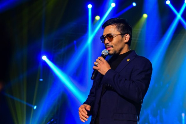 Manny Pacquiao speaks on the mic during a charity concert