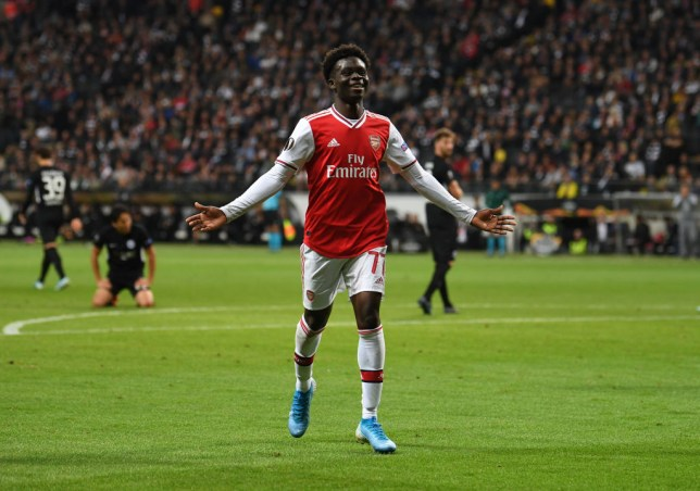 Bukayo Saka celebrates scoring for Arsenal