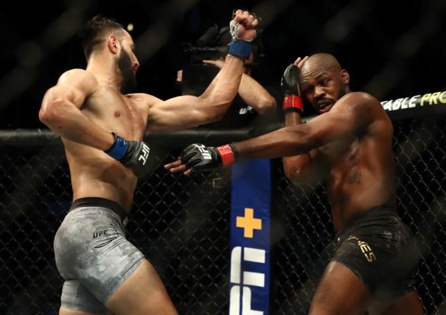 Dominick Reyes throws an uppercut at Jon Jones during their UFC fight