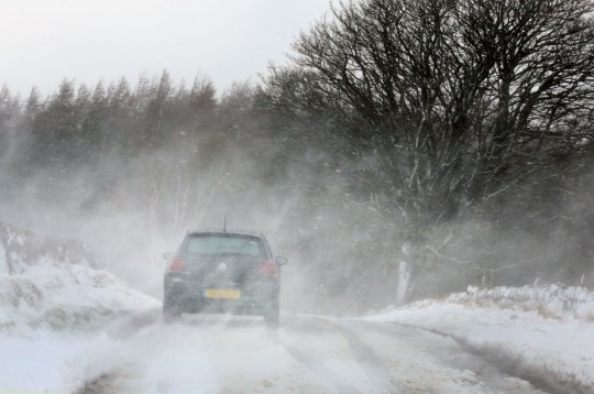 a car driving in a storm in the scottish borders