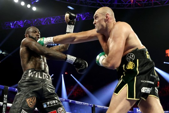 Tyson Fury punches Deontay Wilder in their boxing match