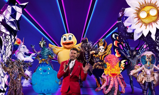 The Masked Singer host Joel Dommett with the contestants