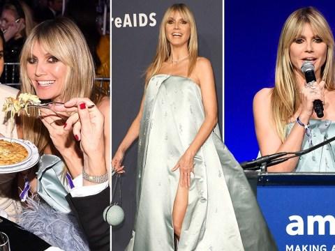 Heidi Klum flashes some leg and tucks into pasta while attending 2020 amfAR gala in New York