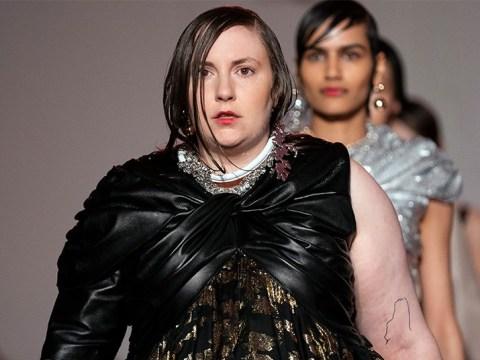 Lena Dunham struts down the runway in huge gold dress and heels at London Fashion Week