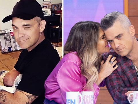 Robbie Williams blissful as he cradles newborn baby Beau in Ayda Field's first video