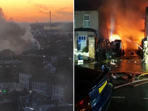 100 firefighters battle huge blaze at London car workshop