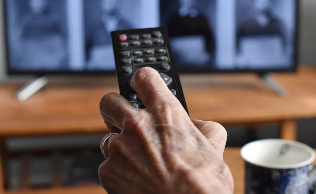 """File photo dated 15/01/20 of an elderly person watching TV. Hundreds of thousands of over-75s could struggle to pay utility bills because of planned changes to the TV licence fee system, according to Age UK. PA Photo. Issue date: Wednesday January 22, 2020. From June, only low-income over-75 viewers who receive pension credits will be entitled to a free TV license in a move that will be a """"shock to the budgets of many older people"""", a statement from the charity said. See PA story MEDIA AgeUK. Photo credit should read: Nick Ansell/PA Wire"""