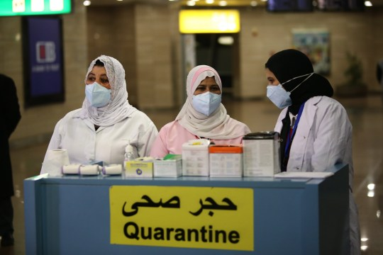 epa08186028 Airport officials wait to screen the temperature of passengers in order to detect a possible coronavirus infection, at Cairo International Airport, in Cairo, Egypt, 01 February 2020. The coronavirus, called 2019-nCoV, originating from Wuhan, China, has spread to all the 31 provinces of China as well as more than a dozen countries in the world. The outbreak of coronavirus has so far claimed 259 lives and infected more than 11,000 others, according to media reports. EPA/STR