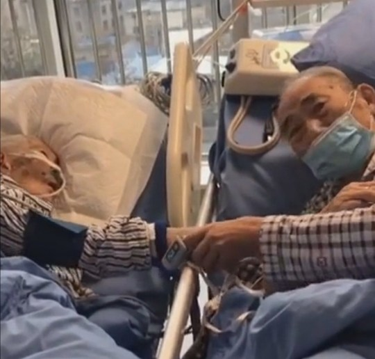 Pic shows: Couple on their deathbed saying goodbye to each other. This heartbreaking footage - now seen 14 million times in less than 24 hours - shows a poorly pensioner???s final farewell to his dying wife inside a hospital???s intensive care unit.