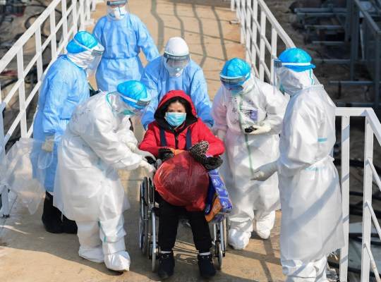 Medical staff transfer patients to the newly completed Huoshenshan temporary field Hospital in Wuhan, Hubei Province, China 04 February 2020.