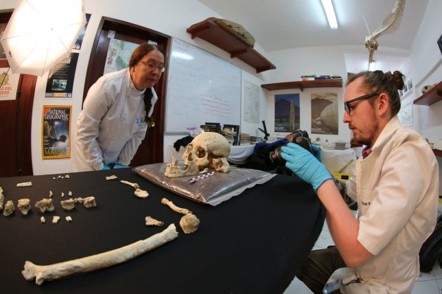 EMBARGOED TO 1900 WEDNESDAY FEBRUARY 5 Undated handout photo issued by Jeronimo Aviles/Plos One showing Professor Silvia Gonzalez (left) and Dr Sam Rennie (right) describing the Chan Hol 3 skull . PA Photo. Issue date: Wednesday February 5, 2020. The 10,000-year-old skeleton discovered in Mexico has challenged the theory that humans first entered the American continents as a single population. See PA story SCIENCE Paleoindian. Photo credit should read: Jeronimo Aviles Olgui/Plos One/PA Wire NOTE TO EDITORS: This handout photo may only be used in for editorial reporting purposes for the contemporaneous illustration of events, things or the people in the image or facts mentioned in the caption. Reuse of the picture may require further permission from the copyright holder.