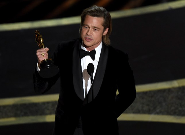 "Brad Pitt accepts the award for best performance by an actor in a supporting role for ""Once Upon a Time in Hollywood"" at the Oscars"