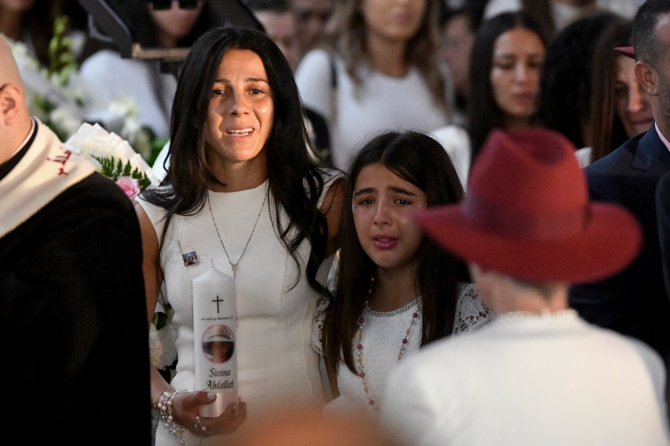 Mother Leila Geagea (left) and her daughter are seen entering the church for the funeral for Anthony Abdallah, 13, Angelina Abdallah, 12, and Sienna Abdallah, 8, at Our Lady of Lebanon Co-Cathedral in Sydney, Monday, February 10, 2020. The three siblings were run down and killed by an alleged drunk driver in Oatlands, in Sydney's west. (AAP Image/Bianca De Marchi) NO ARCHIVING