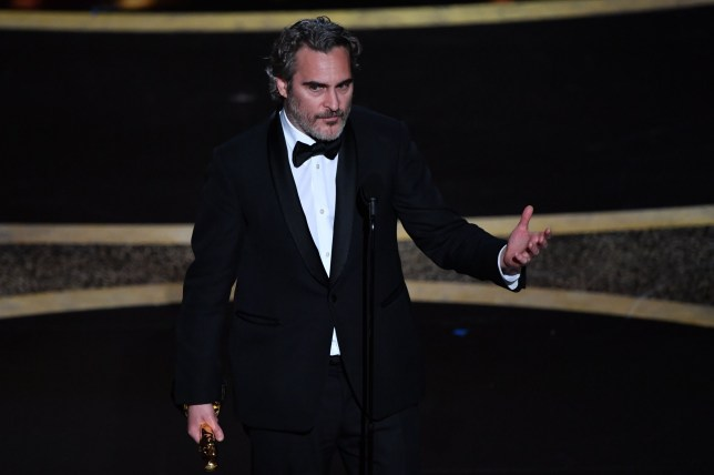 """US actor Joaquin Phoenix accepts the award for Best Actor for """"Joker"""" onstage during the 92nd Oscars"""