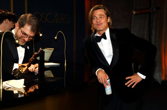 Best Supporting Actor Brad Pitt waits for his Oscar statue to be engraved at the Governors Ball following the 92nd Academy Awards in Los Angeles, California, U.S., February 9, 2020. REUTERS/Eric Gaillard