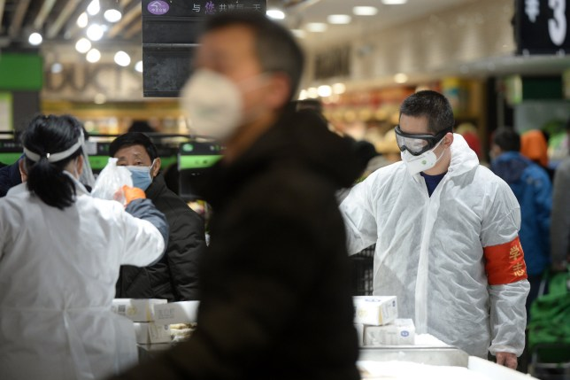 Customers wearing face masks shop inside a supermarket following an outbreak of the novel coronavirus in Wuhan, Hubei province, China February 10, 2020. China Daily via REUTERS ATTENTION EDITORS - THIS IMAGE WAS PROVIDED BY A THIRD PARTY. CHINA OUT.